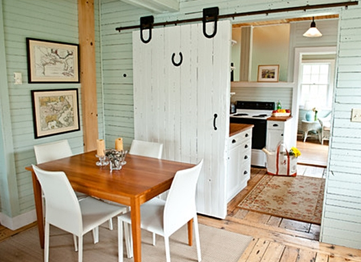 farmhouse sliding door in rustic farmhouse between kitchen and hall